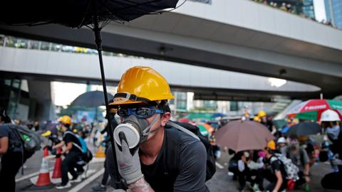 China warns Hong Kong protesters against playing with 'fire'