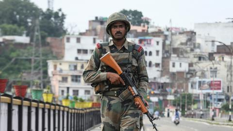 Troops lock down Kashmir as India votes to strip its status