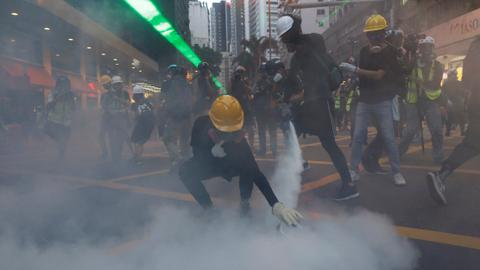 Police and protesters clash in downtown Hong Kong