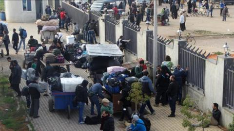 Thousands of rebels and their families evacuated from Syria's Al Waer