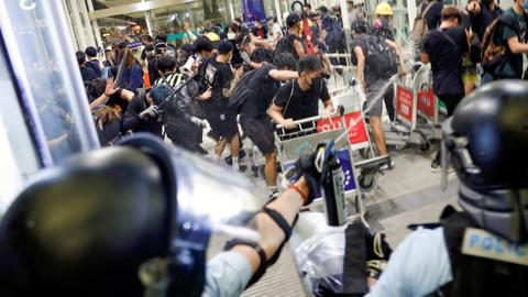 Hong Kong airport reopens after overnight clashes, mass protests