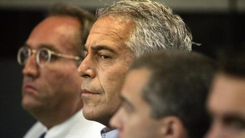 Two guards suspended and warden reassigned after Epstein death