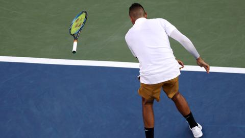 Fiery Kyrgios smashes racquets, tosses shoes in loss