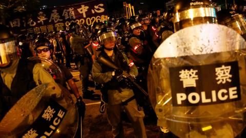 Riot police in Hong Kong face off with protesters after sit-in