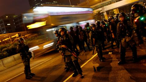 HK police use tear gas, protesters cut down 'smart lamppost'