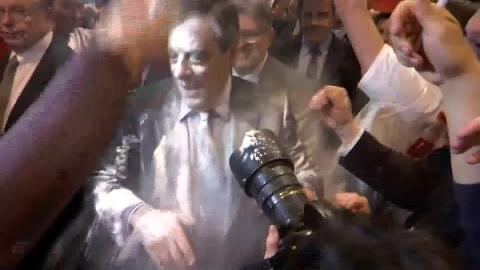 Demonstrator flour-bombs French presidential candidate Fillon