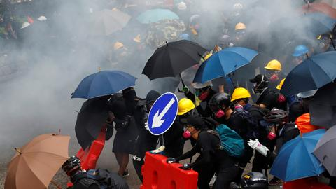 Hong Kong police fire tear gas at protesters defying rally ban
