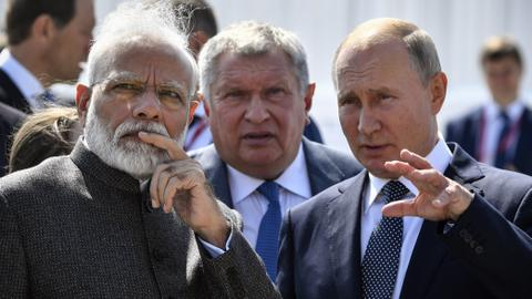 In pictures: Putin meets Modi in Russia, Qatar unveils World Cup 2022 logo