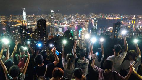 Hong Kong protesters plan shopping mall sit-ins after hill-top human chains