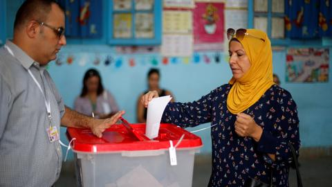 A lawyer and a media mogul claim victory in Tunisia's presidential election