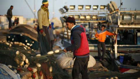 Palestinian fishermen struggle to earn their catch