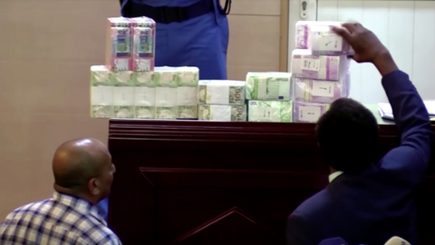 Stacks of cash on display at Bashir trial