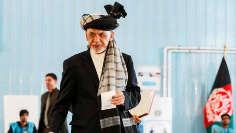 Front-runners each claim victory in Afghan election