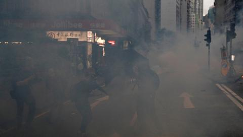 Police fire tear gas as large crowds defy Hong Kong mask ban