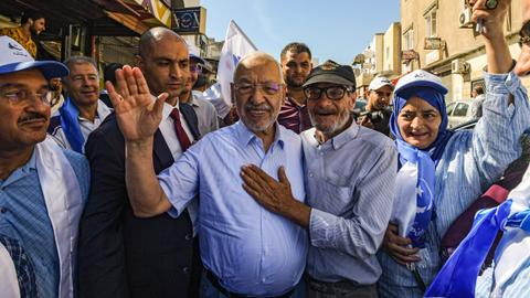 Exit polls show Ennahda party leading Tunisia election