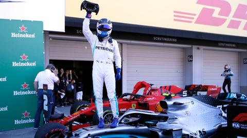 Bottas wins in Japan as Mercedes take sixth title in a row