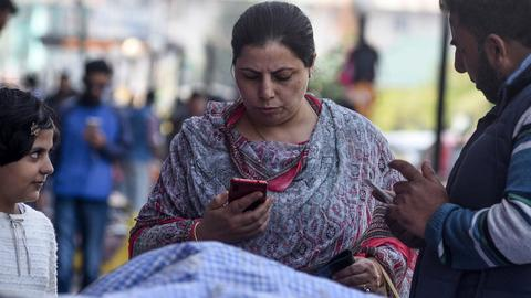 India blocks SMS services in restive Kashmir, arrests women activists