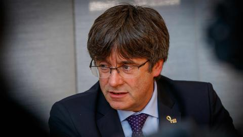 Ex-Catalan leader hands himself into Belgian authorities