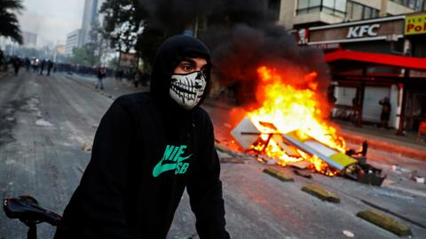 Riots in Chile's Santiago leave three dead
