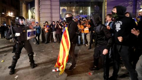 Separatists clash with police in Barcelona after huge rally