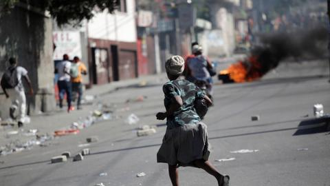 Two dead as hundreds of police, supporters march in Haiti