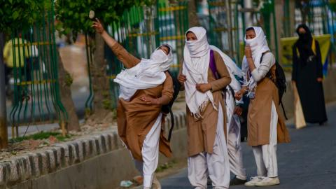 Students and Indian police clash as protests intensify in Kashmir