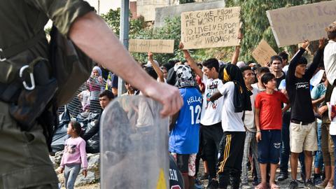 Spike in refugee arrivals as Greek asylum bill prompts backlash