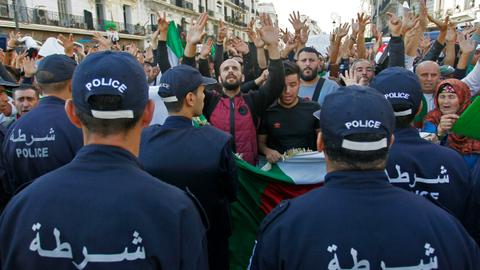 Algerian protesters march on in defiance of 'The Power'
