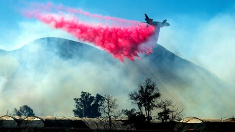 Southern California blaze sears homes, orchards, threatens oil fields