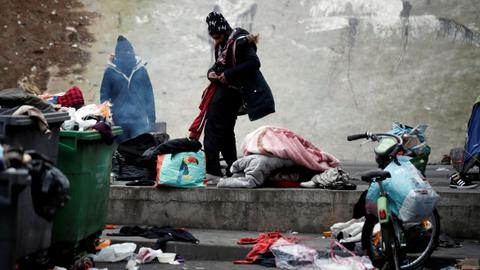 French police clear refugee tent camps in northern Paris