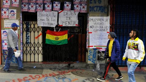 Protesters seize state-run media in Bolivia as tensions soar