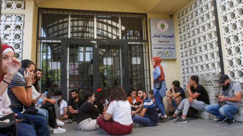 Lebanese banks, schools shut as protesters push on