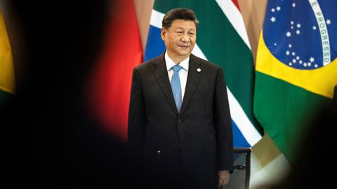 China's Xi wants US trade deal but 'not afraid' to fight back