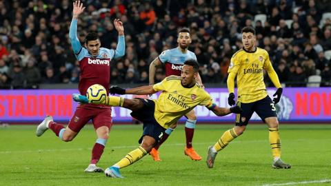 Football: Arsenal stage comeback to sink West Ham and end winless run
