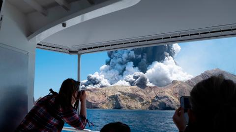 Eruption fears halt plans to recover bodies from New Zealand volcano
