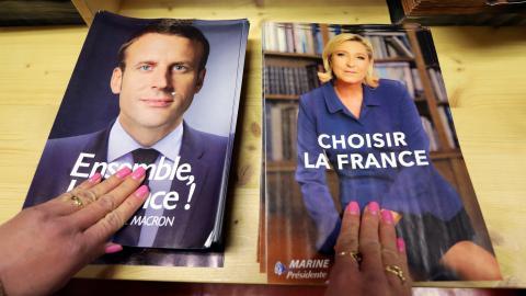 What divides Macron and Le Pen?