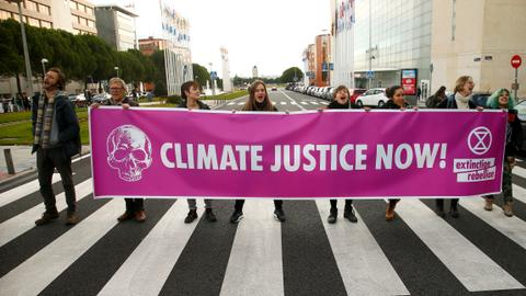 EU clashes over climate, as breakaway Britain votes