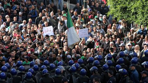 Algeria holds presidential vote fiercely opposed by protesters