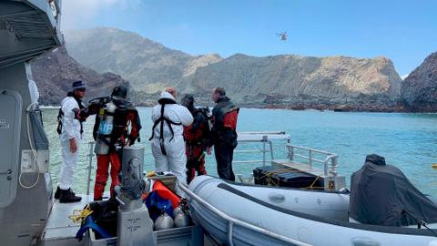 New Zealand divers attempt to recover last two victims from volcanic island