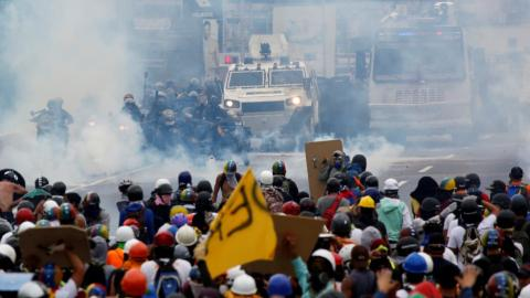 Riot police fire tear gas as Venezuelan opposition protests
