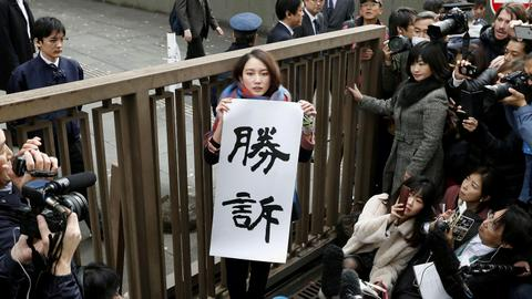 Tokyo court awards damages to female journalist in rape case