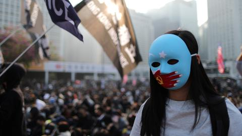 Police break up Hong Kong rally for China's Uighurs