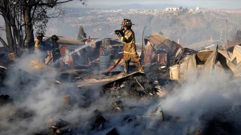Dozens of homes damaged by wildfire in hills over Chile city