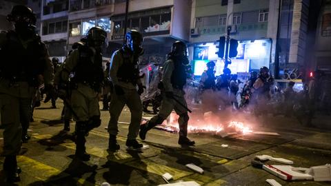Police fire tear gas as Hong Kong rings in New Year