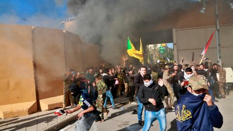 US troops fire tear gas at pro-Iran protesters in Iraq
