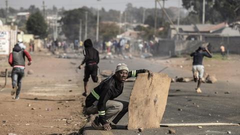 South African police and protesters clash for fourth day