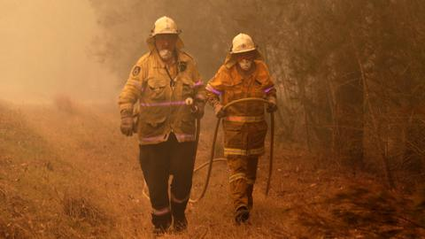 Australian PM calls up reservists as fire threats escalate