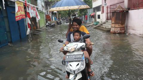 Indonesia braces for more downpours as flood toll hits 66