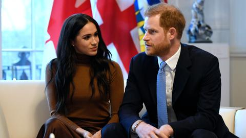 Harry and wife Meghan bid farewell to royal roles