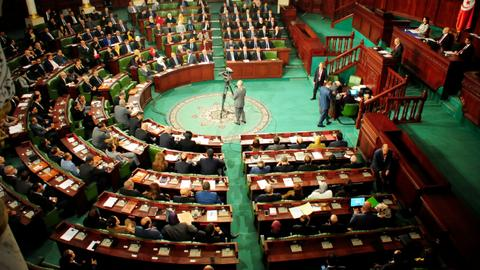 Tunisian parliament rejects government, coalition building must restart
